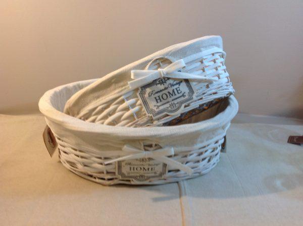 Set 2 cesti bianchi ovali foderati in tessuto panna con scritta