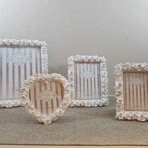 Coccole di Casa Porta foto in resina con bordo con rose 20x25