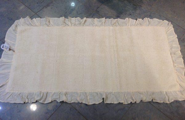 Nuvole di Stoffa tappetino color burro con frappa 55x100