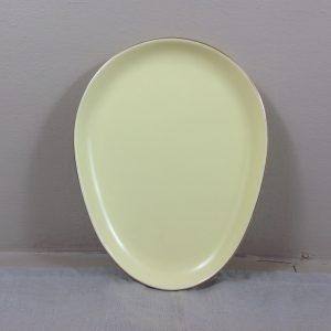 Piatto a forma di uovo giallino