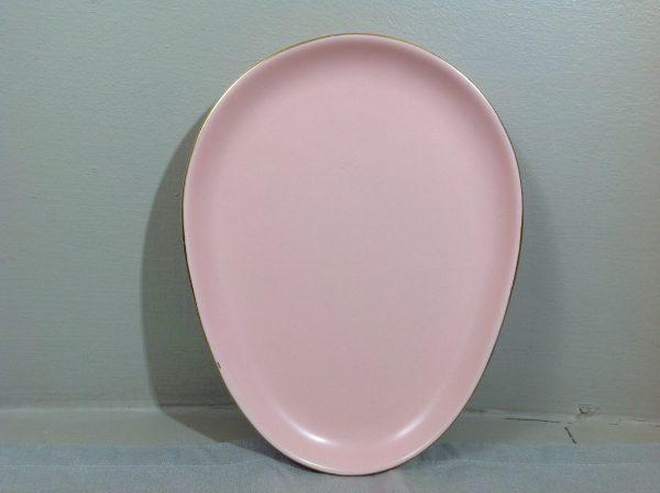 Piatto a forma di uovo rosa