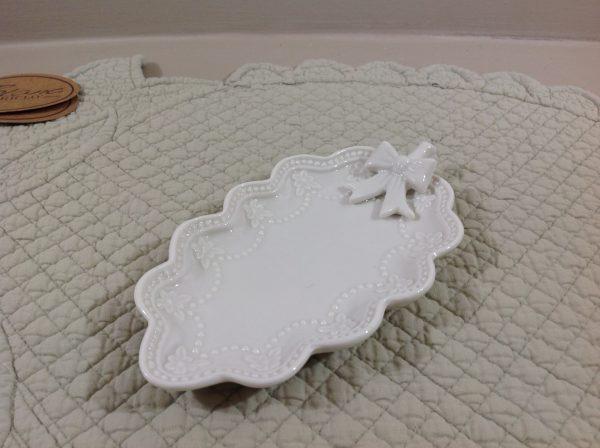 Coccole di Casa Piattino ovale in porcellana bianca con fiocco